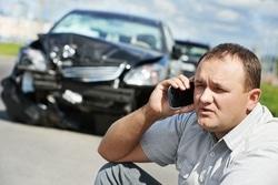 Guy on phone crashed car Cash for Cars Edmonton